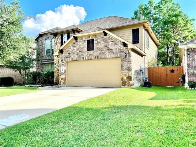 134 Magnolia Grove Lane, Conroe, TX 77384 (MLS #47202118) :: Guevara Backman