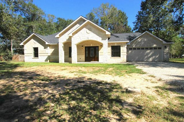 206 County Road 3310B, Cleveland, TX 77327 (MLS #4771646) :: NewHomePrograms.com LLC