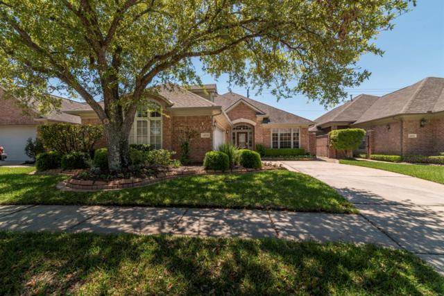 14034 Bay Oaks Boulevard, Houston, TX 77059 (MLS #48456933) :: The SOLD by George Team