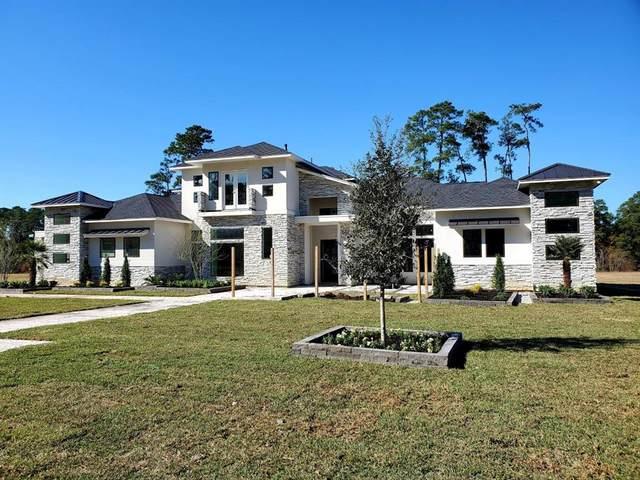 106 Kings Lake Estates Boulevard, Houston, TX 77346 (MLS #49696083) :: Michele Harmon Team