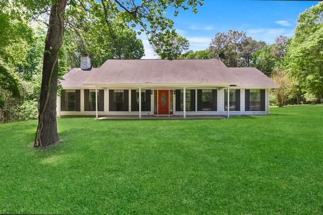 201 Arneson Lane, Coldspring, TX 77331 (MLS #49808323) :: The Home Branch