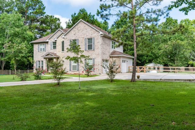 29702 Lake Commons Way, Huffman, TX 77336 (MLS #50536829) :: The SOLD by George Team