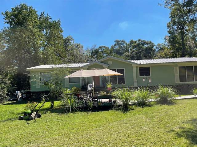 439 County Road 370, Splendora, TX 77372 (MLS #50599815) :: The SOLD by George Team