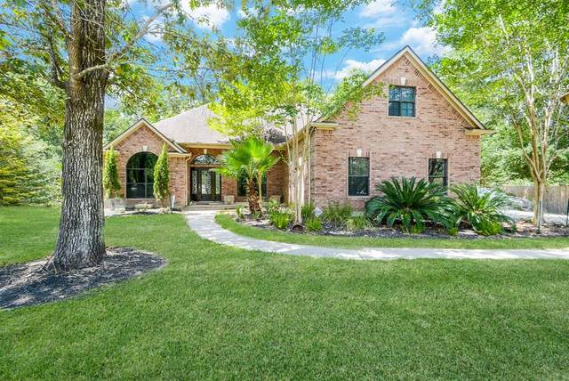8827 Catamaran Way, Montgomery, TX 77316 (MLS #50657935) :: The Andrea Curran Team powered by Compass