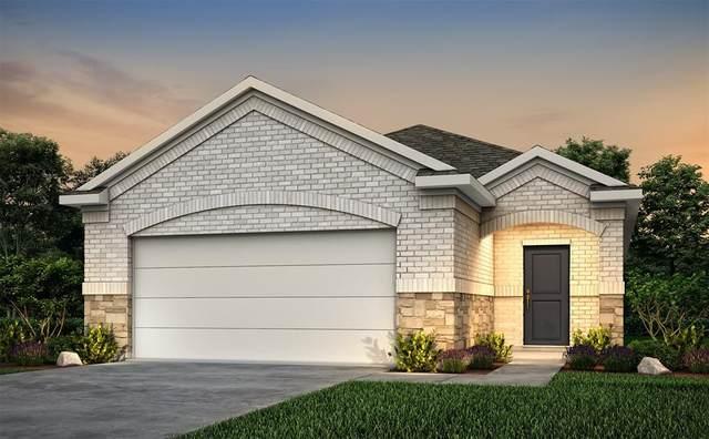 927 Redinger Ridge Drive, Huffman, TX 77336 (MLS #50695677) :: The Freund Group