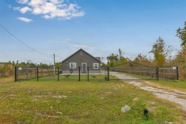 1421 County Road 3558, Cleveland, TX 77327 (MLS #51195391) :: The Home Branch