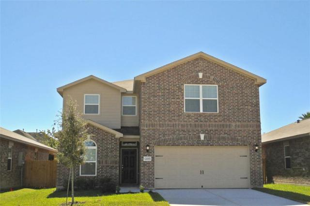 12015 Powderhorn Lane, Pinehurst, TX 77362 (MLS #52504573) :: Grayson-Patton Team