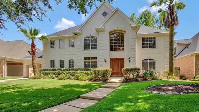 15418 Greens Cove Way, Houston, TX 77059 (MLS #52579177) :: Christy Buck Team