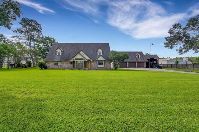 1307 Mere Drive, Pinehurst, TX 77362 (#52658679) :: ORO Realty