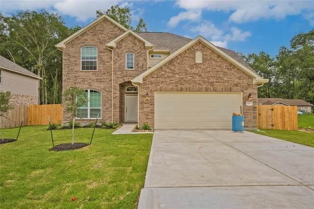 655 W Linnwood Drive, New Caney, TX 77357 (MLS #54319349) :: Michele Harmon Team