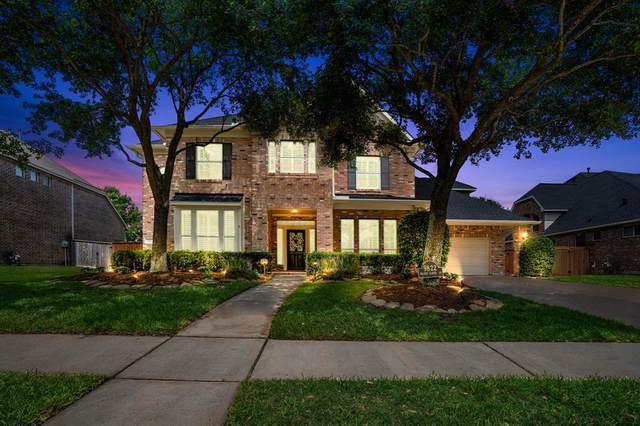 9822 Prairie Clover Lane, Spring, TX 77379 (MLS #55621242) :: Michele Harmon Team