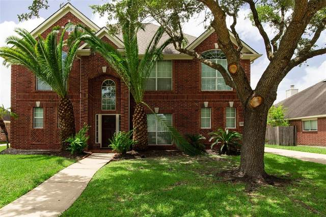410 Serenity Drive, Dickinson, TX 77539 (MLS #55747534) :: The SOLD by George Team