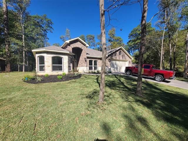 1410 River Oaks Drive, Huntsville, TX 77340 (MLS #56268105) :: TEXdot Realtors, Inc.