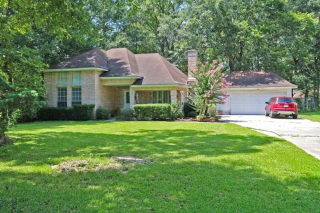 2303 Hummingbird Street, Roman Forest, TX 77357 (MLS #56466602) :: The SOLD by George Team
