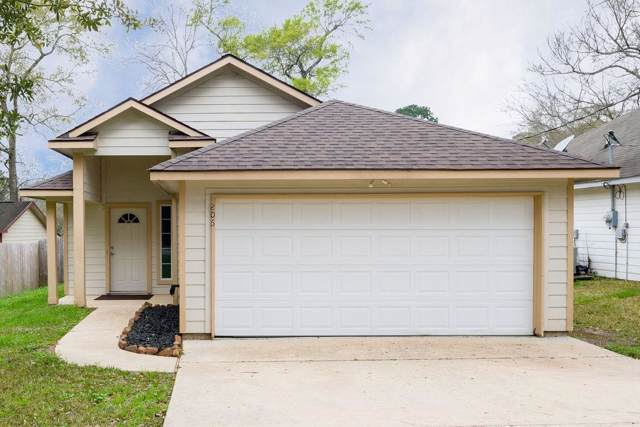 206 Tejas Boulevard, Conroe, TX 77316 (MLS #56612313) :: The Parodi Team at Realty Associates