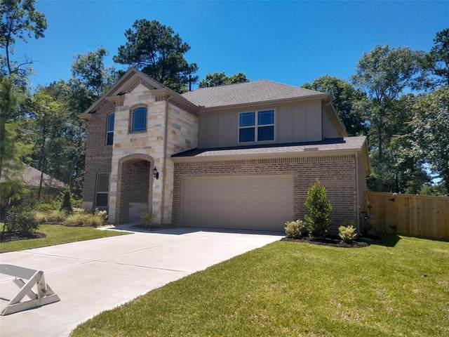 219 Speckled Woods Place, Conroe, TX 77318 (MLS #56758043) :: Giorgi Real Estate Group