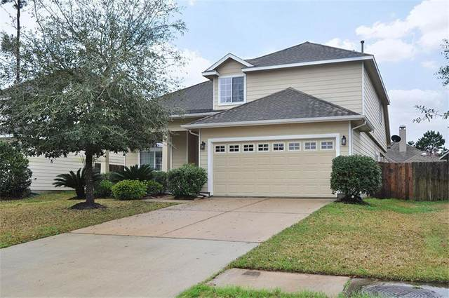12230 Sunlight Peak Lane, Humble, TX 77346 (MLS #58213338) :: The Parodi Team at Realty Associates