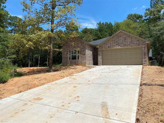 14768 Bowie, Willis, TX 77378 (MLS #58772088) :: The SOLD by George Team