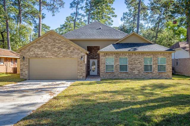 210 Swift Current, Huffman, TX 77336 (MLS #59817543) :: The SOLD by George Team