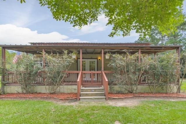 1336 County Road 2224, Cleveland, TX 77327 (MLS #59867170) :: NewHomePrograms.com LLC