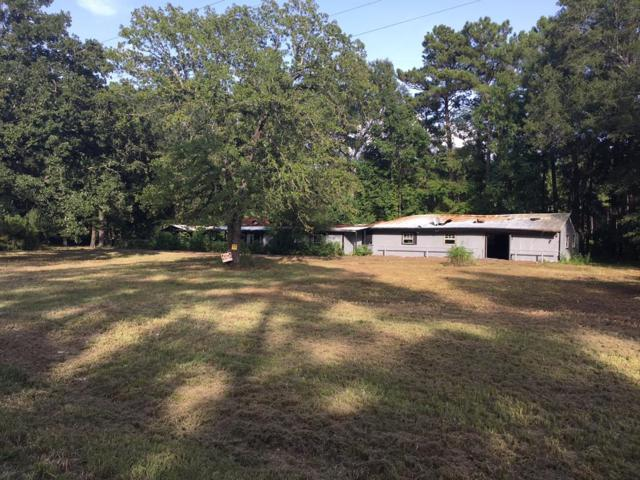 2910 Fm 2610 Road, Cleveland, TX 77327 (MLS #63795051) :: Texas Home Shop Realty