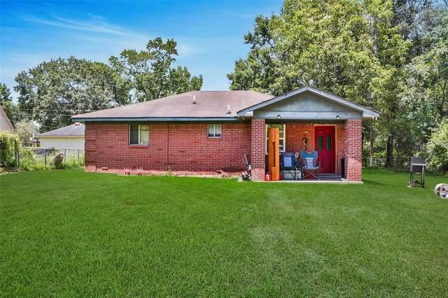 22961 Woodland Drive, Porter, TX 77365 (MLS #64864411) :: Michele Harmon Team