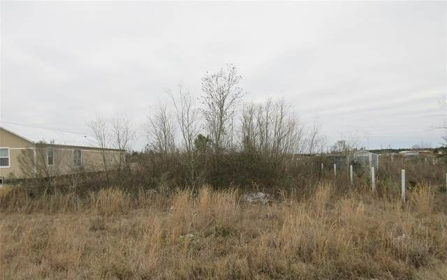 824 County Road 3558, Cleveland, TX 77327 (MLS #67413268) :: The Property Guys