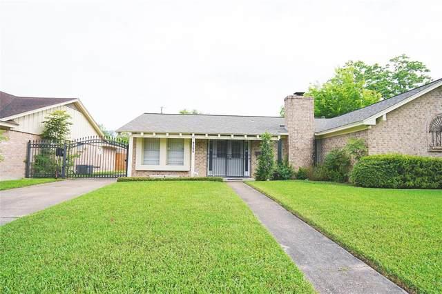 9306 Rowan Lane, Houston, TX 77036 (MLS #67699830) :: The SOLD by George Team