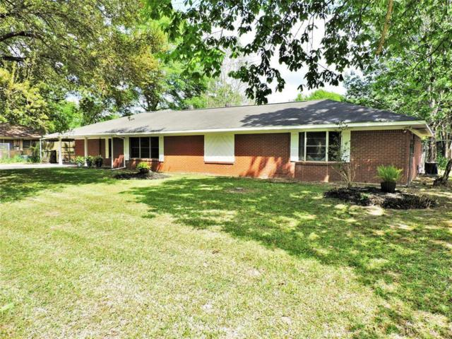 1205 S Fenner Avenue, Cleveland, TX 77327 (MLS #68247623) :: NewHomePrograms.com LLC