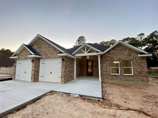 215 Kings Row, Roman Forest, TX 77357 (MLS #68389505) :: The Freund Group