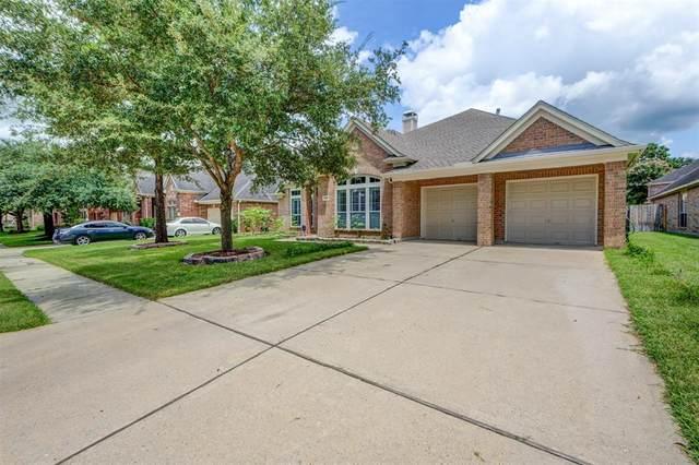 25702 Serene Spring Lane, Spring, TX 77373 (MLS #68461417) :: My BCS Home Real Estate Group