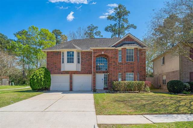 21831 Whispering Forest Drive, Kingwood, TX 77339 (MLS #68514579) :: The SOLD by George Team