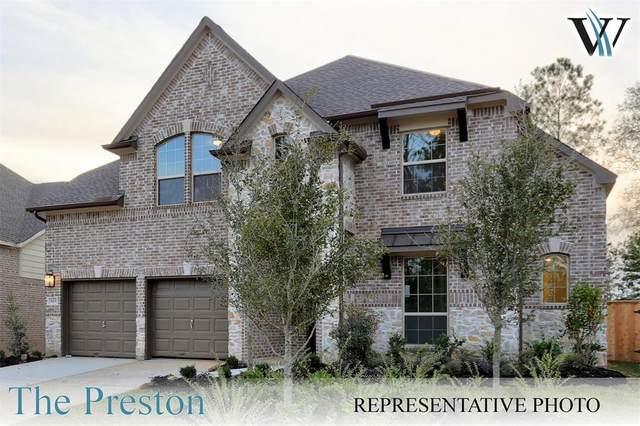 319 S Cadence Hills Loop, Willis, TX 77318 (#69864316) :: ORO Realty