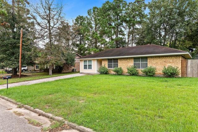 202 N Forest Drive, Willis, TX 77378 (MLS #69933500) :: NewHomePrograms.com LLC