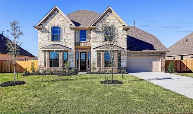 11731 Oakwood Drive, Mont Belvieu, TX 77535 (MLS #69938977) :: Christy Buck Team