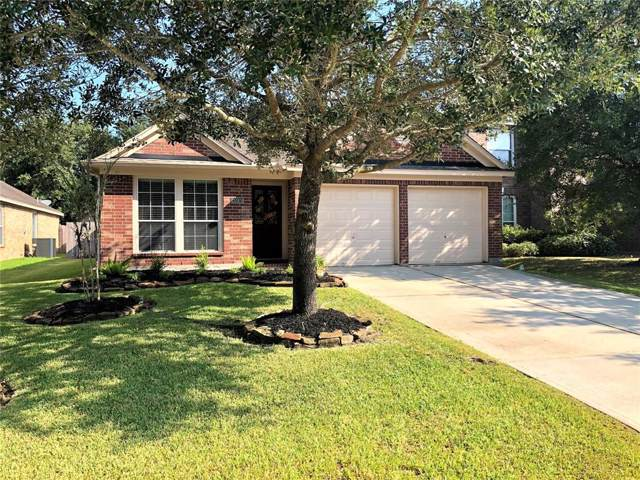 26924 Carriage Manor Lane, Kingwood, TX 77339 (MLS #69985838) :: The Parodi Team at Realty Associates