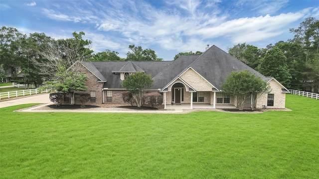 31011 Edgewater Drive, Magnolia, TX 77354 (MLS #70578848) :: Michele Harmon Team