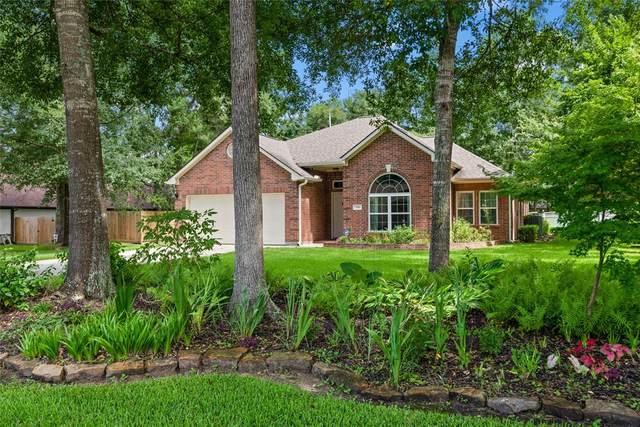 7510 Oak Bluff Drive, Magnolia, TX 77354 (MLS #70590480) :: My BCS Home Real Estate Group