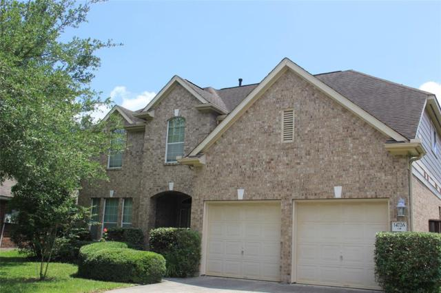 14726 Raven Hollow Lane, Humble, TX 77396 (MLS #70686617) :: The Heyl Group at Keller Williams