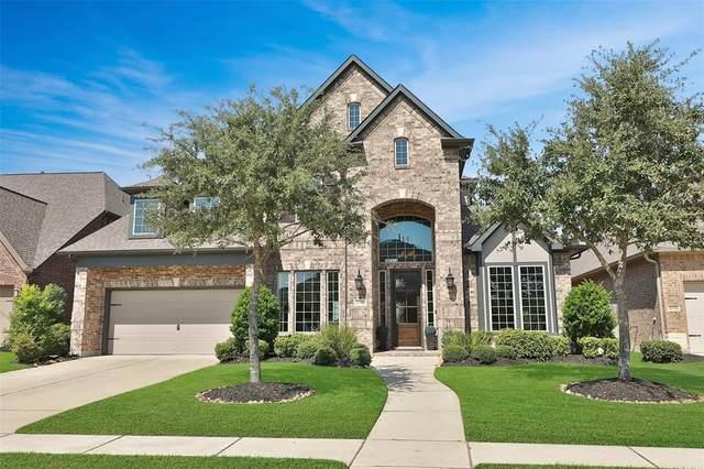 10327 Millcreek Manor Lane, Cypress, TX 77433 (MLS #70800791) :: The Freund Group