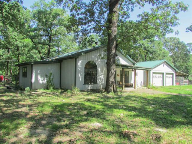 27 Grace Lane W, Huntsville, TX 77320 (MLS #71007090) :: The Heyl Group at Keller Williams