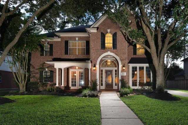 9611 Woodcliff Lake Drive, Spring, TX 77379 (MLS #71586404) :: The SOLD by George Team