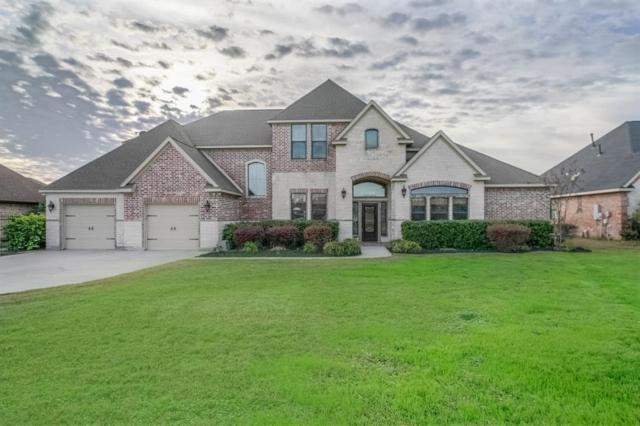 11731 W Grand Pond Drive, Montgomery, TX 77356 (MLS #72644715) :: The Heyl Group at Keller Williams
