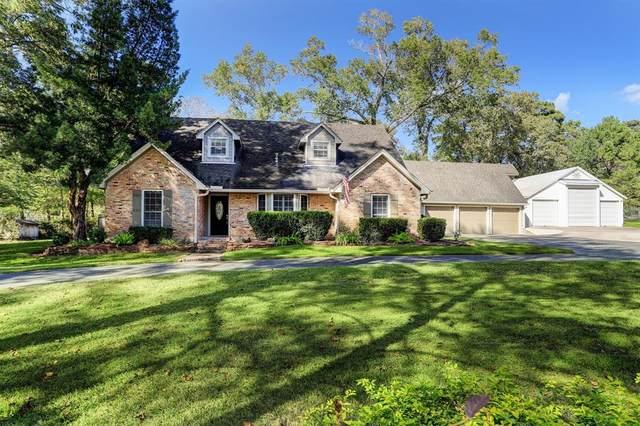 1301 Cypress Lane, Kingwood, TX 77339 (MLS #73539470) :: Michele Harmon Team
