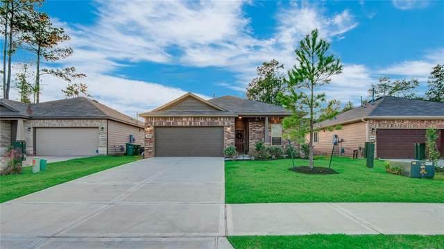 4226 Amber Ruse Drive, Conroe, TX 77304 (MLS #73959713) :: NewHomePrograms.com