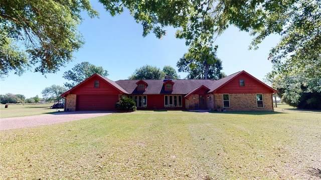 829 S Van Ostrand Lane, Stowell, TX 77661 (MLS #73964576) :: The Sansone Group
