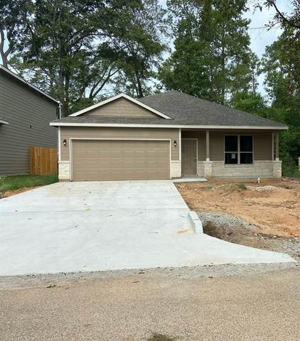 11721 Sycamore Street, Conroe, TX 77302 (MLS #7458709) :: The SOLD by George Team