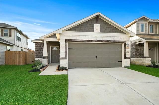 14207 Grand Hills Drive, Conroe, TX 77303 (MLS #75726504) :: Michele Harmon Team