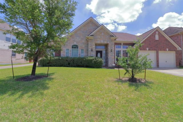 24414 Split Rock Falls, Tomball, TX 77375 (MLS #75969851) :: NewHomePrograms.com LLC