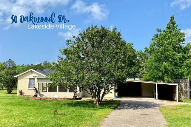 50 Oakwood Drive, Huntsville, TX 77320 (MLS #76079672) :: The SOLD by George Team